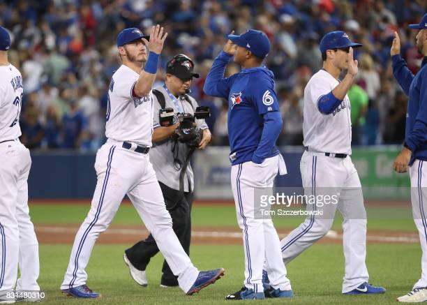 Josh Donaldson of the Toronto Blue Jays celebrates their victory with Marcus Stroman during MLB game action against the Tampa Bay Rays at Rogers...