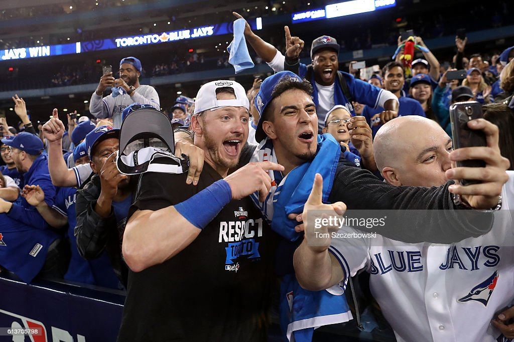 Josh Donaldson #20 of the Toronto Blue Jays celebrates with fans after the Toronto Blue Jays defeated the Texas Rangers 7-6 for game three of the American League Division Series at Rogers Centre on October 9, 2016 in Toronto, Canada.