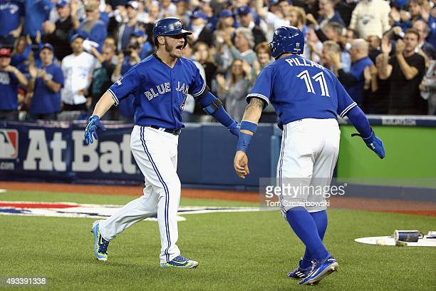 Josh Donaldson of the Toronto Blue Jays celebrates with Kevin Pillar of the Toronto Blue Jays after hitting a tworun home run in the third inning...
