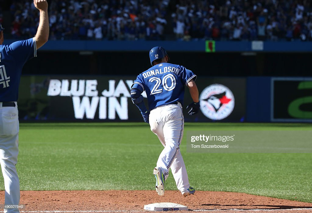 Josh Donaldson #20 of the Toronto Blue Jays circles the bases after hitting a game-winning solo home run in the ninth inning during MLB game action against the Tampa Bay Rays on September 27, 2015 at Rogers Centre in Toronto, Ontario, Canada.