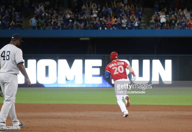 Josh Donaldson of the Toronto Blue Jays circles the bases after hitting a solo home run in the eighth inning during MLB game action against the New...