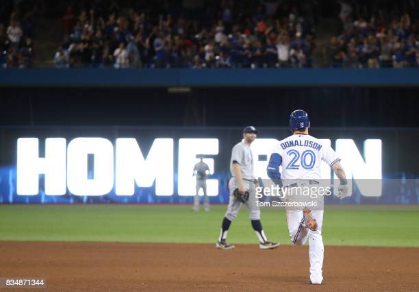 Josh Donaldson of the Toronto Blue Jays circles the bases after hitting a solo home run in the fifth inning during MLB game action against the Tampa...