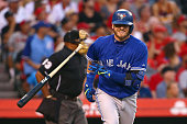 Josh Donaldson of the Toronto Blue Jays grins as he tosses his bat aside after hitting a threerun homerun against the Los Angeles Angels of Anaheim...