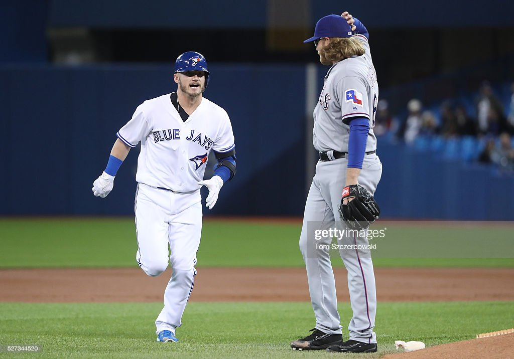Josh Donaldson #20 of the Toronto Blue Jays has words for former teammate A.J. Griffin #64 of the Texas Rangers after taking an inside pitch and then flying out in the first inning during MLB game action on May 2, 2016 at Rogers Centre in Toronto, Ontario, Canada.