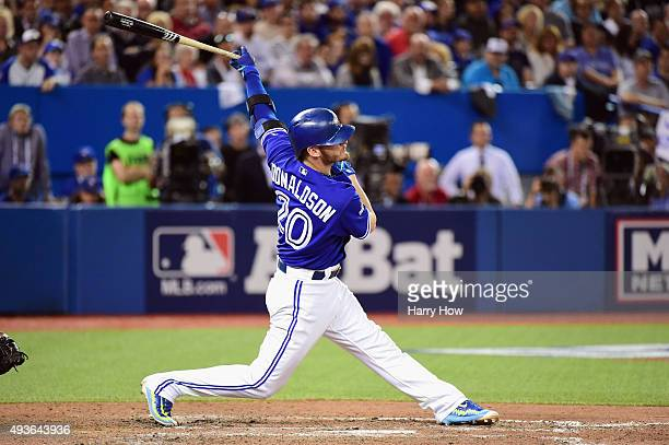 Josh Donaldson of the Toronto Blue Jays hits a double against the seventh inning against the Kansas City Royals during game five of the American...