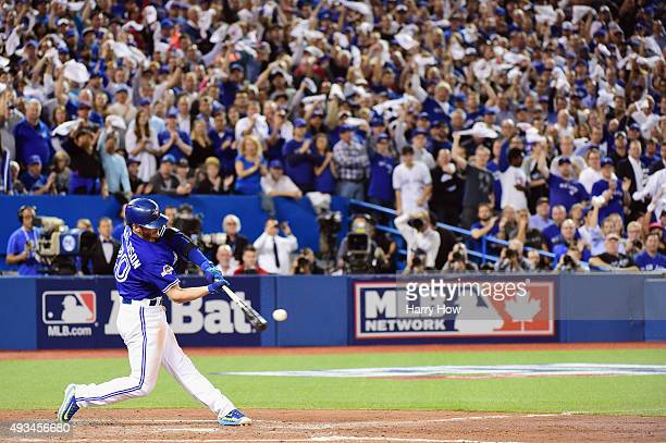 Josh Donaldson of the Toronto Blue Jays hits a ground rule double to score Ryan Goins of the Toronto Blue Jays in the third inning against the Kansas...
