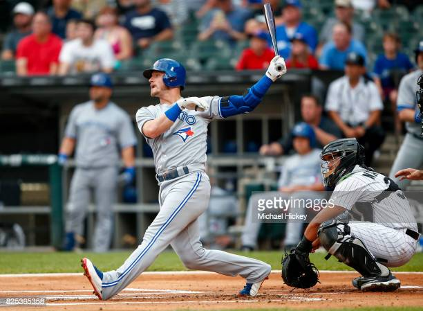 Josh Donaldson of the Toronto Blue Jays hits a home run during the first inning against the Chicago White Sox at Guaranteed Rate Field on August 1...