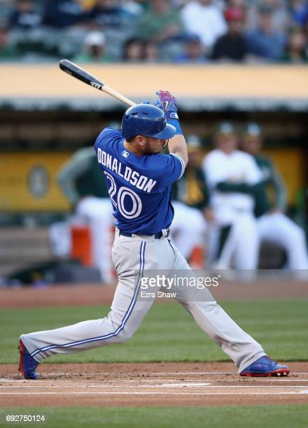 Josh Donaldson of the Toronto Blue Jays hits a RBI double in the first inning against the Oakland Athletics at Oakland Alameda Coliseum on June 5...