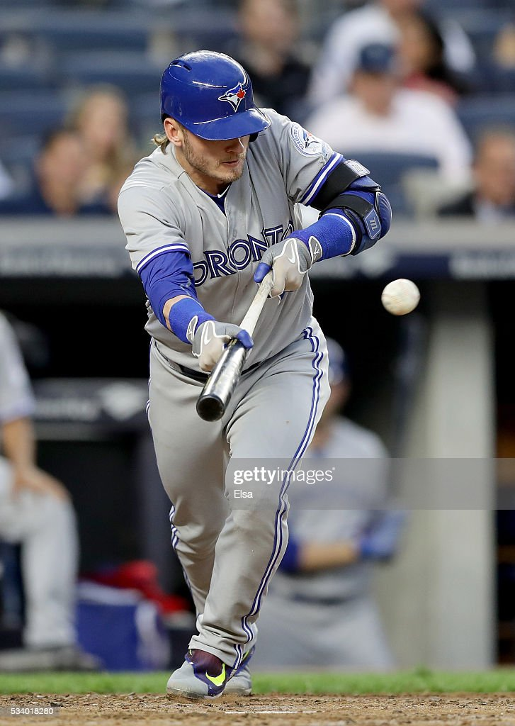 <a gi-track='captionPersonalityLinkClicked' href=/galleries/search?phrase=Josh+Donaldson&family=editorial&specificpeople=4959442 ng-click='$event.stopPropagation()'>Josh Donaldson</a> #20 of the Toronto Blue Jays hits a sacrifice bunt in the third inning against the New York Yankees at Yankee Stadium on May 24, 2016 in the Bronx borough of New York City.