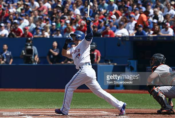 Josh Donaldson of the Toronto Blue Jays hits a solo home run in the first inning during MLB game action against the Detroit Tigers on August 30 2015...