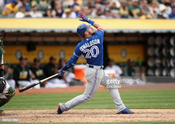 Josh Donaldson of the Toronto Blue Jays hits a tworun home run in the tenth inning against the Oakland Athletics at Oakland Alameda Coliseum on June...