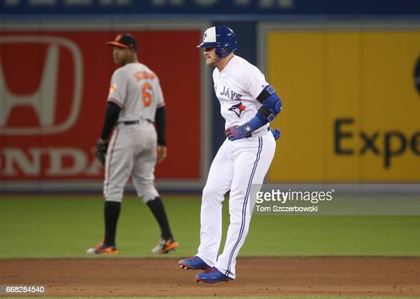 Josh Donaldson of the Toronto Blue Jays hobbles into second base after injuring his leg running out an RBI double in the sixth inning during MLB game...