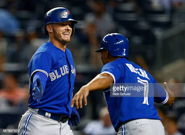 Josh Donaldson of the Toronto Blue Jays is congratulated by Ben Revere after he hit a two run home run against the New York Yankees during the first...