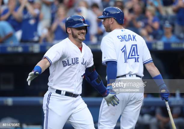 Josh Donaldson of the Toronto Blue Jays is congratulated by Justin Smoak after hitting a tworun home run in the first inning during MLB game action...