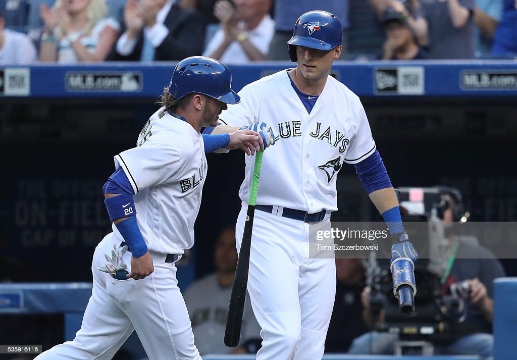 <a gi-track='captionPersonalityLinkClicked' href=/galleries/search?phrase=Josh+Donaldson&family=editorial&specificpeople=4959442 ng-click='$event.stopPropagation()'>Josh Donaldson</a> #20 of the Toronto Blue Jays is congratulated by <a gi-track='captionPersonalityLinkClicked' href=/galleries/search?phrase=Michael+Saunders+-+Baseball+Player&family=editorial&specificpeople=10553013 ng-click='$event.stopPropagation()'>Michael Saunders</a> #21 after scoring a run in the first inning during MLB game action against the New York Yankees on May 30, 2016 at Rogers Centre in Toronto, Ontario, Canada.