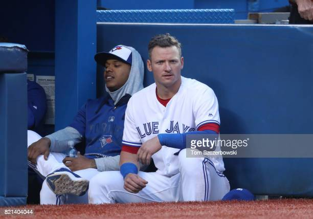 Josh Donaldson of the Toronto Blue Jays looks on from the top step of the dugout beside Marcus Stroman during MLB game action against the Baltimore...