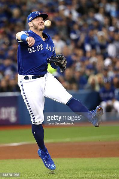 Josh Donaldson of the Toronto Blue Jays makes a throw to first base for the second out of the seventh inning against the Texas Rangers during game...