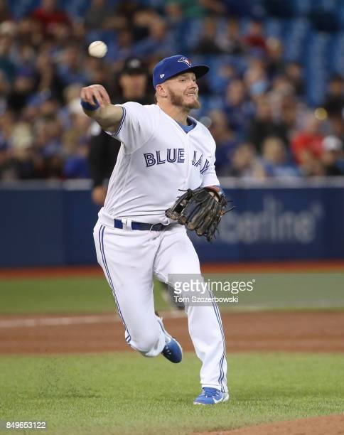 Josh Donaldson of the Toronto Blue Jays makes the play and throws out the baserunner in the sixth inning during MLB game action against the Baltimore...