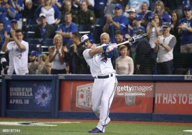 Josh Donaldson of the Toronto Blue Jays prepares for his pinchhit at bat as he swings in the ondeck circle in the ninth inning during MLB game action...