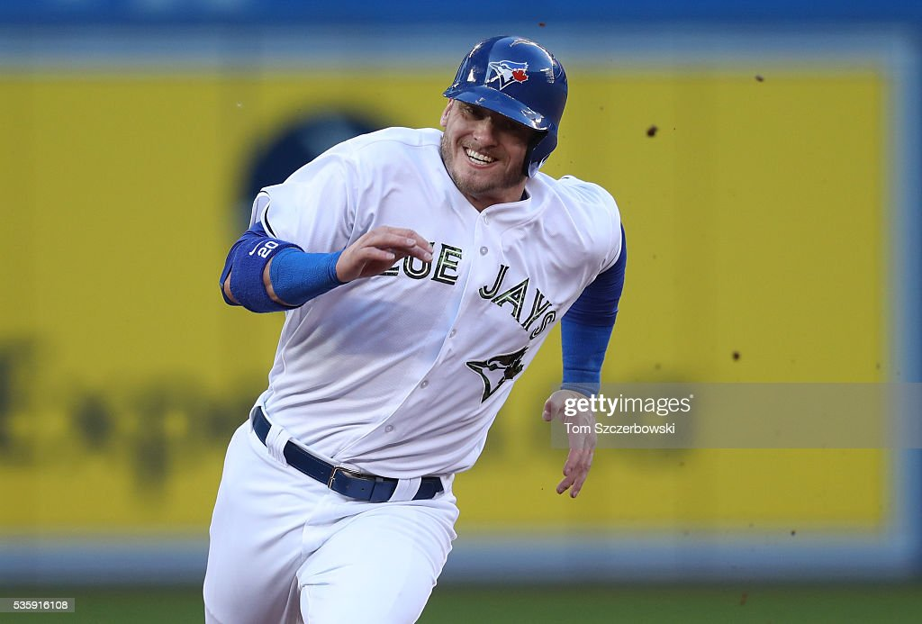 <a gi-track='captionPersonalityLinkClicked' href=/galleries/search?phrase=Josh+Donaldson&family=editorial&specificpeople=4959442 ng-click='$event.stopPropagation()'>Josh Donaldson</a> #20 of the Toronto Blue Jays races home as he scores from first base on an RBI double by <a gi-track='captionPersonalityLinkClicked' href=/galleries/search?phrase=Edwin+Encarnacion&family=editorial&specificpeople=598285 ng-click='$event.stopPropagation()'>Edwin Encarnacion</a> #10 in the first inning during MLB game action against the New York Yankees on May 30, 2016 at Rogers Centre in Toronto, Ontario, Canada.