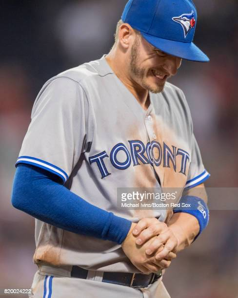 Josh Donaldson of the Toronto Blue Jays reacts after injuring his thumb against the Boston Red Sox in the eleventh inning at Fenway Park on July 18...