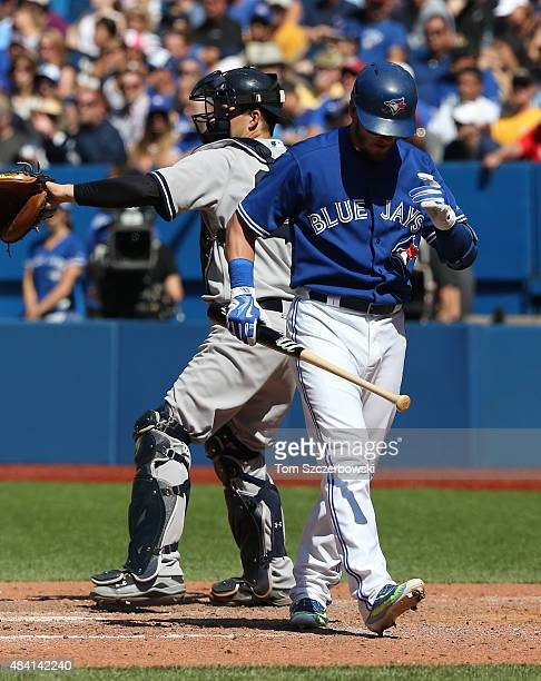 Josh Donaldson of the Toronto Blue Jays reacts after striking out in the eighth inning during MLB game action as John Ryan Murphy of the New York...