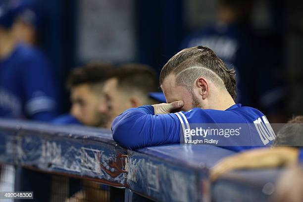 Josh Donaldson of the Toronto Blue Jays reacts from the dugout in the 14th inning against the Texas Rangers during game two of the American League...