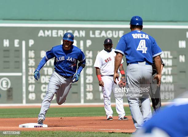 Josh Donaldson of the Toronto Blue Jays rounds third base after hitting a one run homer against the Boston Red Sox in the first inning at Fenway Park...