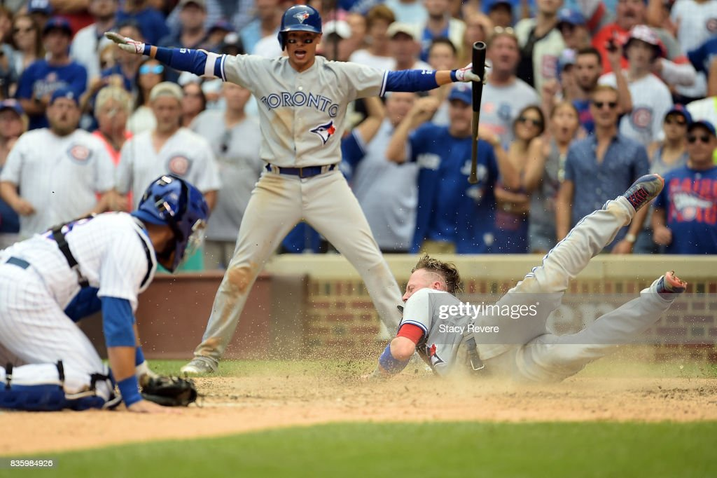 Josh Donaldson #20 of the Toronto Blue Jays scores a run during the tenth inning of a game against the Chicago Cubs at Wrigley Field on August 20, 2017 in Chicago, Illinois.