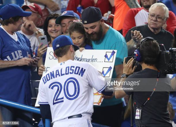 Josh Donaldson of the Toronto Blue Jays signs autographs for fans before the start of MLB game action against the Baltimore Orioles at Rogers Centre...