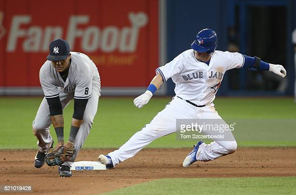 Josh Donaldson of the Toronto Blue Jays slides into second base safely as he leads off the eighth inning with a double during MLB game action as...