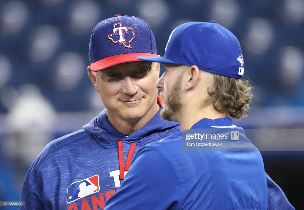 Josh Donaldson #20 of the Toronto Blue Jays talks to manager Jeff Bannister #28 of the Texas Rangers before the start of their MLB game on May 2, 2016 at Rogers Centre in Toronto, Ontario, Canada.