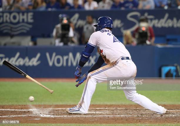 Josh Donaldson of the Toronto Blue Jays throws his bat at the ball as he fouls off a pitch in the seventh inning during MLB game action against the...