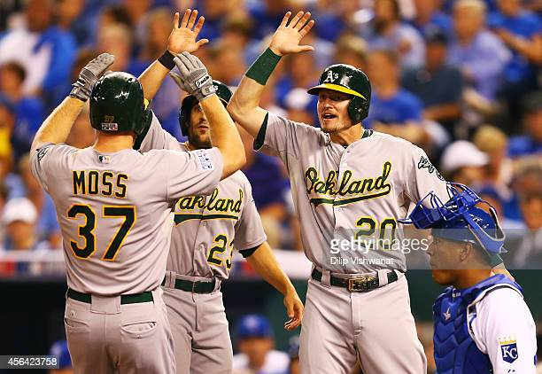 Josh Donaldson Sam Fuld and Brandon Moss of the Oakland Athletics celebrate after Moss' threerun home run in the sixth inning against the Kansas City...