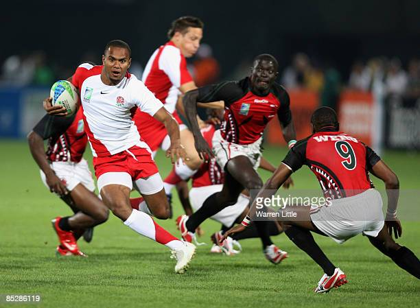 Josh Drauniniu of England in action during the Pool E match between England and Kenya at the IRB Rugby World Cup Sevens 2009 at The Sevens stadium on...