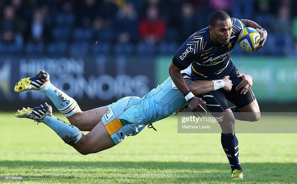Josh Drauniniu of Worcester is tackled by <a gi-track='captionPersonalityLinkClicked' href=/galleries/search?phrase=George+Pisi&family=editorial&specificpeople=783455 ng-click='$event.stopPropagation()'>George Pisi</a> of Noryhampton during the Aviva Premiership match between Worcester Warriors and Northampton Saints at Sixways Stadium on February 16, 2013 in Worcester, England.