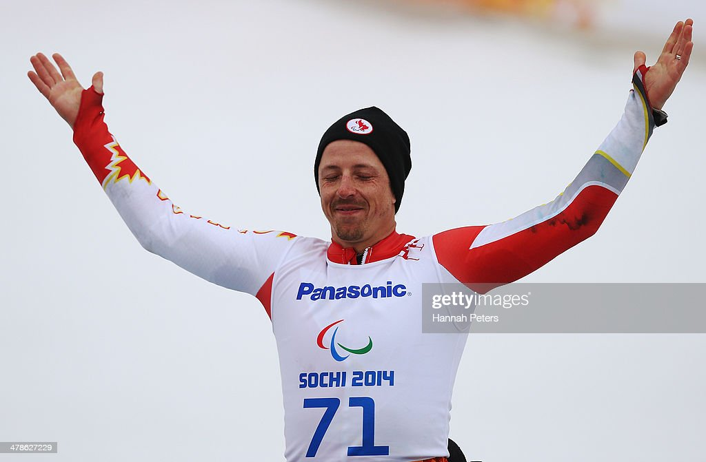 Josh Dueck of Canada celebrates winning the gold medal in the Men's Super Combined Sitting Super G during the flower ceremony on day seven of the...