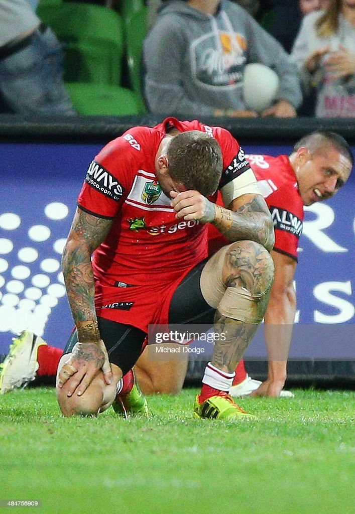 Josh Dugan (L) and Gerard Beale of the Dragons react after their defeat during the round 6 NRL match between the Melbourne Storm and the St George Illawarra Dragons at AAMI Park on April 14, 2014 in Melbourne, Australia.