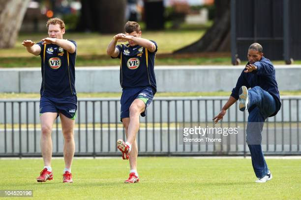 Josh Dugan and Joel Monaghan run drills as a local Redfern man joins in training during an Australian Kangaroos training session at Redfern Oval on...