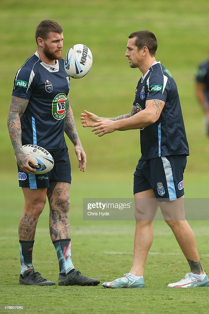 Josh Dugan and Mitchell Pearce warm up during the New South Wales Blues State of Origin team training session at the Novotel on June 11, 2015 in Coffs Harbour, Australia.