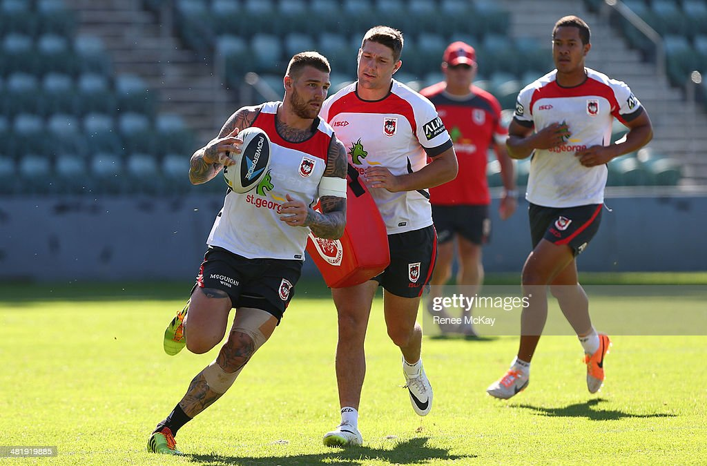 <a gi-track='captionPersonalityLinkClicked' href=/galleries/search?phrase=Josh+Dugan&family=editorial&specificpeople=5553377 ng-click='$event.stopPropagation()'>Josh Dugan</a>, <a gi-track='captionPersonalityLinkClicked' href=/galleries/search?phrase=Gareth+Widdop&family=editorial&specificpeople=6349002 ng-click='$event.stopPropagation()'>Gareth Widdop</a> and Kyle Stanley run a play during a St George Illawarra Dragons NRL training session at WIN Stadium on April 2, 2014 in Wollongong, Australia.
