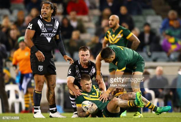 Josh Dugan of Australia fractured his check bone in this tackle during the ANZAC Test match between the Australian Kangaroos and the New Zealand...