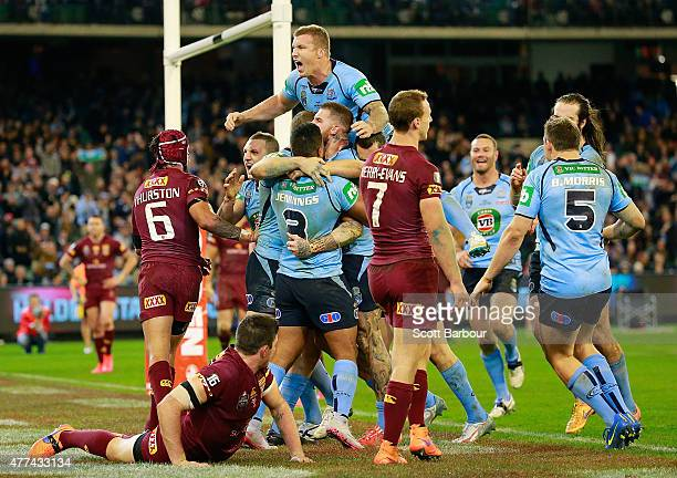 Josh Dugan of the Blues celebrates with his teammates after scoring a try during game two of the State of Origin series between the New South Wales...