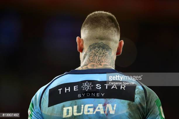 Josh Dugan of the Blues looks on during game three of the State Of Origin series between the Queensland Maroons and the New South Wales Blues at...