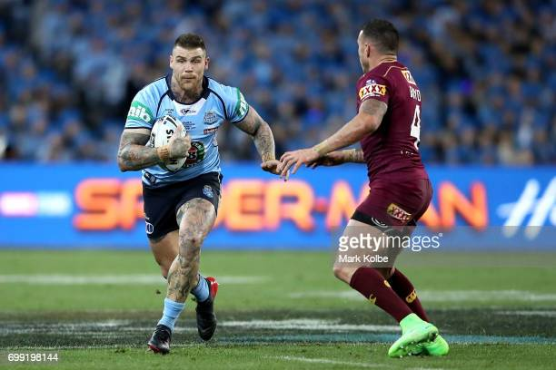 Josh Dugan of the Blues runs the ball during game two of the State Of Origin series between the New South Wales Blues and the Queensland Maroons at...