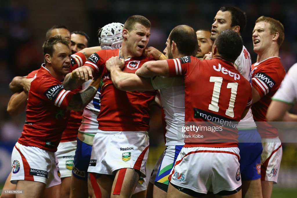 <a gi-track='captionPersonalityLinkClicked' href=/galleries/search?phrase=Josh+Dugan&family=editorial&specificpeople=5553377 ng-click='$event.stopPropagation()'>Josh Dugan</a> of the Dragons and his team mates scuffle with Raiders players during the round 20 match between the St George Illawarra Dragons and the Canberra Raiders at WIN Stadium on July 27, 2013 in Wollongong, Australia.