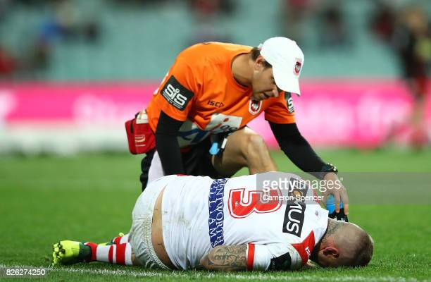 Josh Dugan of the Dragons appears injured during the round 22 NRL match between the St George Illawarra Dragons and the South Sydney Rabbitohs at...