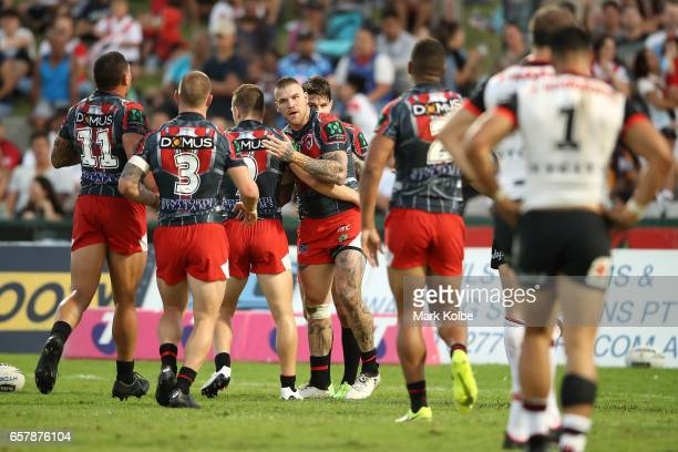 Josh Dugan of the Dragons celebrates with his team mates after scoring a try during the round four NRL match between the St George Illawarra Dragons...