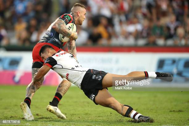 Josh Dugan of the Dragons evades the tackle of Roger TuivasaSheck of the Warriors on way to scoring a try during the round four NRL match between the...