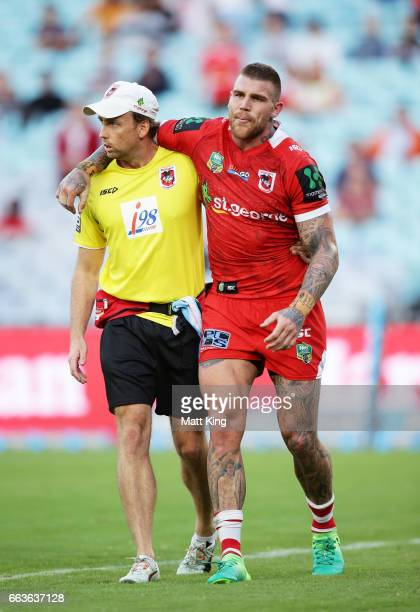 Josh Dugan of the Dragons is assisted from the field after sustaining an injury during the round five NRL match between the Wests Tigers and the St...